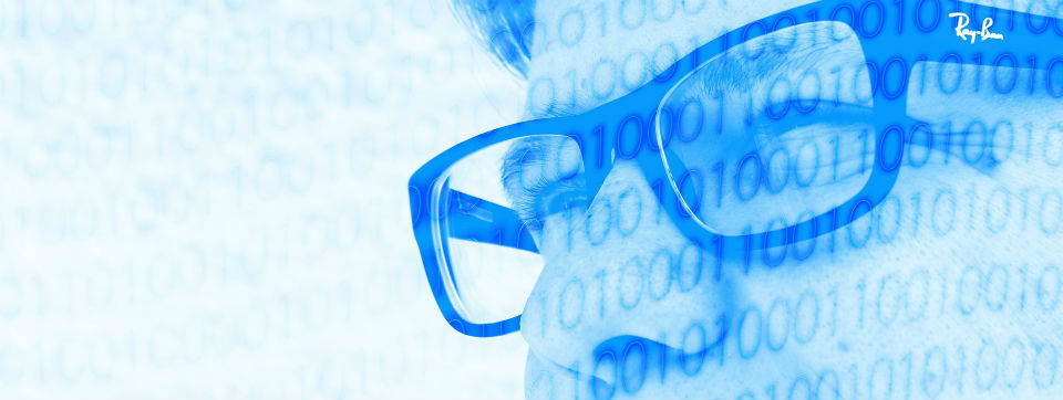 Man wearing glasses with binary code superimposed